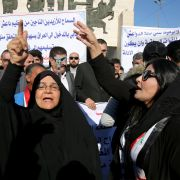 Iraqis demand investigations March 1, 2019, in Baghdad into the discovery of a mass grave near the Islamic State's last bastion in eastern Syria.