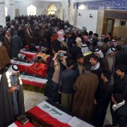 Iraqis gather in a mosque in Najaf on Feb. 20, 2019, to mourn victims who were reportedly abducted and killed by armed men on motorbikes.