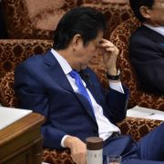 Japanese Prime Minister Shinzo Abe sits in the Japanese parliament, the Diet, on March 24, 2017.