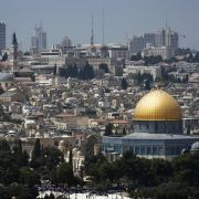 The gilded Dome of the Rock mosque gleams in the sunlight shining on Jerusalem's skyline.