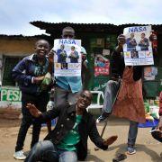 Supporters of Kenyan opposition National Super Alliance (NASA) leader Raila Odinga celebrate in the streets of the Mathare slum in Nairobi on Sept. 1.