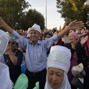 Local residents attend a meeting with Kyrgyz opposition lawmaker and presidential candidate Omurbek Babanov in the town of Tokmok.