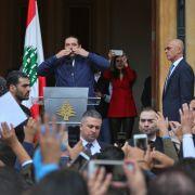 Lebanese Prime Minister Saad al-Hariri greets supporters in Beirut on Nov. 22, 2017.
