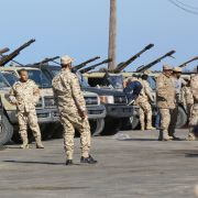 Militia members from Misrata, who support Libya's Government of National Accord, arrive in a Tripoli suburb on April 6, 2019, ready to defend the capital from an assault by the Libyan National Army, led by Field Marshal Khalifa Hifter.