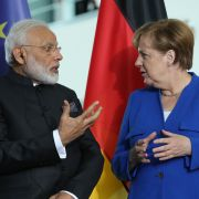 German Chancellor Angela Merkel and Indian Prime Minister Narendra Modi chat during a signing ceremony of contracts between the German and Indian governments at the Chancellery in Berlin on May 30.