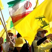 Hezbollah supporters wave the militant group's flag at a rally in Lebanon in August 2016. With its vast network of operatives scattered around the world, Hezbollah has demonstrated its ability to stage attacks in unexpected locations to further its cause.
