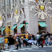 By this time next year, consumers, like these holiday shoppers in New York City, might see the effects of inflation's return. Such signs as stabilizing commodities prices and a bond sell-off point to the return of increasing prices.