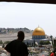 A man looks toward the Dome of the Rock and al-Aqsa mosque compound in Jerusalem on April 24.
