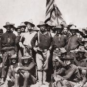 Theodore Roosevelt stands with the First Cavalry Volunteers on San Juan Hill during the Spanish-American War.