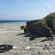 An abandoned Cold War-era pillbox near Hualien on Taiwan's east coast, now collapsed because of coastal erosion.