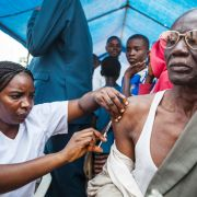 In Kinshasa, a man receives a vaccination against yellow fever, which has spread to the Democratic Republic of the Congo from Angola, where an outbreak began in late 2015. Though it has attracted far less attention than the Zika virus, an outbreak of yellow fever could turn into a global concern if it spreads along economic lines from Angola and the Democratic Republic of the Congo to China.
