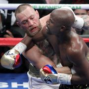Mixed martial arts star Conor McGregor (L) competes with boxer Floyd Mayweather Jr. in Las Vegas on Aug. 26.
