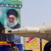 An Iranian military truck carries a Sejjil missile past a portrait of Supreme Leader Ayatollah Ali Khamenei during a Sept. 22, 2013, military parade in Tehran marking the anniversary of the start of the 1980-88 Iran-Iraq war.