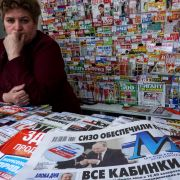 At a newsstand in Moscow, a paper announces Russian President Vladimir Putin's re-election.