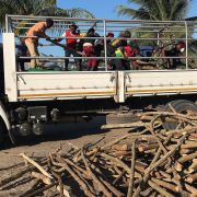 A picture shows internally displaced people and residents unload a truck with goods of first necessity, food and blankets in Naunde, northern Mozambique on June 13, after fleeing the recent attacks.