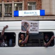 People in the Zimbabwean capital of Harare celebrate longtime President Robert Mugabe's resignation Nov. 21.