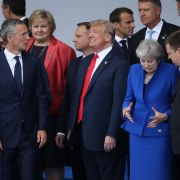 NATO Secretary-General Jens Stoltenberg (L), U.S. President Donald Trump (C) and British Prime Minister Theresa May (R) mingle with other NATO representatives at the opening ceremony for the military bloc's annual summit in Brussels on July 11, 2018.