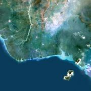 Color satellite image of the Niger Delta region in Nigeria. The city of Lagos, the second-most populous city in Africa, can be seen west of the river on the Atlantic coast.