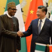 Nigerian President Muhammadu Buhari (L) shakes hands with his Chinese counterpart, Xi Jinping, in Beijing.