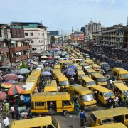 Public transportation minibuses barricade the roads in search of passengers, causing traffic gridlock in Lagos.