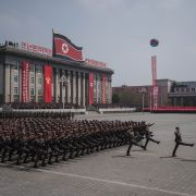 A military parade marches past buildings in North Korea's capital, Pyongyang.