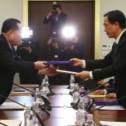 South and North Korean officials exchange joint statements Jan. 9 in the Demilitarized Zone after agreeing that athletes from North Korea would participate in the 2018 Winter Olympics in Pyeongchang, South Korea.