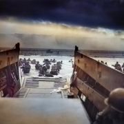 "A digitally colorized image of a photograph by Robert F. Sargent titled ""Into the Jaws of Death."" Sargent captured troops from the United States Army First Infantry Division disembarking from an LCVP (landing craft) onto Omaha Beach during the Normandy Landings on D-Day during World War II, June 6, 1944."