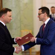 Polish President Andrzej Duda (L) swears in Prime Minister Mateusz Morawiecki on Dec. 8, 2017.