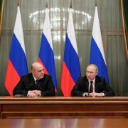 Russian President Vladimir Putin (2R) and Prime Minister Mikhail Mishustin (2L) meet with members of the new government in Moscow on Jan. 21, 2020.