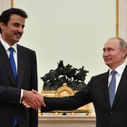 Emir of Qatar Sheikh Tamim bin Hamad Al-Thani (L) shakes hands with Russian President Vladimir Putin during their meeting at the Kremlin in Moscow on July 15.