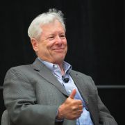 University of Chicago Professor Richard Thaler speaks to guests after learning he had been awarded the Nobel Prize in Economics on Oct. 9.