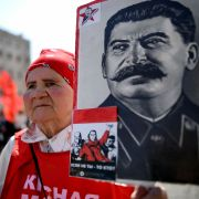 A supporter of Russia's Communist Party brandishes a poster bearing infamous Soviet leader Josef Stalin's likeness during a May Day celebration.
