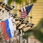 A Russian flag next to the U.S. embassy building in Moscow.