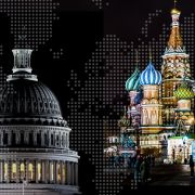 The U.S. Capitol and the Russian Kremlin, both photographed at night.