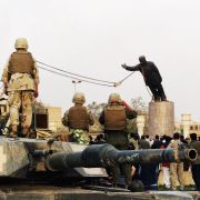 U.S marines and Iraqis are seen on April 9, 2003 as the statue of Iraqi dictator Saddam Hussein is toppled at al-Fardous square in Baghdad, Iraq. The third year anniversary since the overthrow of Saddam Hussein will be marked on April 9, 2006 amidst continued unrest in Iraq, where over 30, 000 civilians have been reported to be killed since the start of the war.