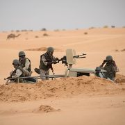Soldiers stand guard at a G5 Sahel task force command post on Nov. 22, 2018, in Mauritania near the border with Mali.