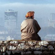 A Bosnia woman takes in the Sarajevo skyline from a location shielded from snipers, Nov. 17, 1995.