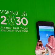 An exhibition at the Dubai World Trade Center advertises Saudi Arabia's Vision 2030 plan.
