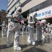 South Korean soldiers in protective suits spray disinfectant on March 2, 2020, in Daegu, South Korea.