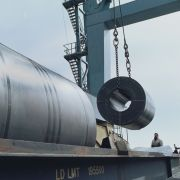 Workers load steel for transport from Holland to its final destination in Ohio.