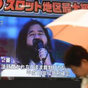 A television screen in Tokyo announces the execution of Shoko Asahara, leader of the Aum Shinrikyo cult, which conducted a deadly attack on the Tokyo subway in 1995.