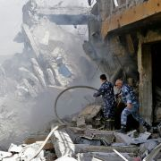 Syrian soldiers inspect the wreckage of a building on April 14, 2018, after the United States, Britain and France launched strikes against Syrian government targets in response to an alleged chemical weapons attack.