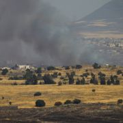 A column of smoke rises from Syria, near its border with the Israeli-occupied Golan Heights, on June 24, 2017, after an Israeli airstrike.