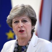 British Prime Minister Theresa May speaks to the press in front of U.K. and EU flags