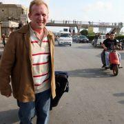 A tourist is a little too obvious as he walks away from Rafik Hariri International Airport in Beirut.