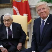 U.S. President Donald Trump (R) meets with former U.S. Secretary of State Henry Kissinger in the Oval Office in October 2017 in Washington.