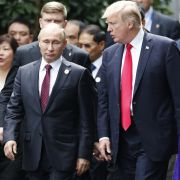 After leaving a NATO summit, U.S. President Donald Trump (right) is scheduled to meet with Russian President Vladimir Putin in Helsinki.