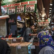 "Vendors sell nuts as people shop under a banner reading ""An End to Inflation"" in Istanbul's Eminonu neighborhood on Nov. 6, 2018."