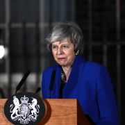 British Prime Minister Theresa May addresses the media at number 10 Downing street after her government defeated a vote of no confidence in the House of Commons, Jan. 16.
