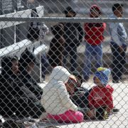 Migrants wait in a detention area on March 31, 2019, in El Paso, Texas.